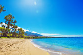 The Kaanapali Beach and resort Hotels on Maui Hawaii. A popular tourist destination on the west coast of the island of Maui. Lined with luxury hotels and entertainment district. Photographed in horizo