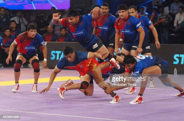 Kabaddi players of Puneri Altan and Dabang Delhi in action during the match of ProKabaddi league at NSCI Worli on July 28 2014 in Mumbai India Dabang...