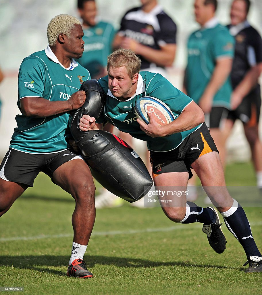 Kabamba Floors and Philip Snyman in action during a Toyota Cheetahs training session at Free State Stadium on July 04, 2012 in Bloemfontein, South Africa.
