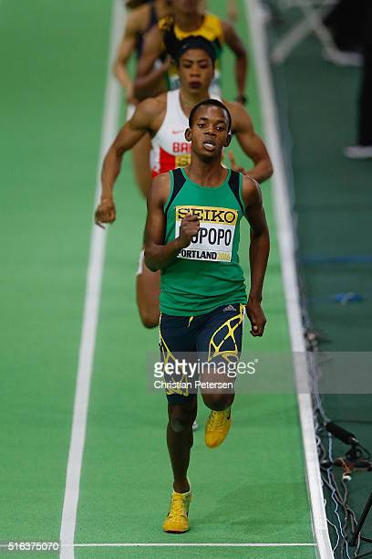 Kabange Mupopo of Zambia competes in the Women's 400 metre heats during day two of the IAAF World Indoor Championships at Oregon Convention Center on...