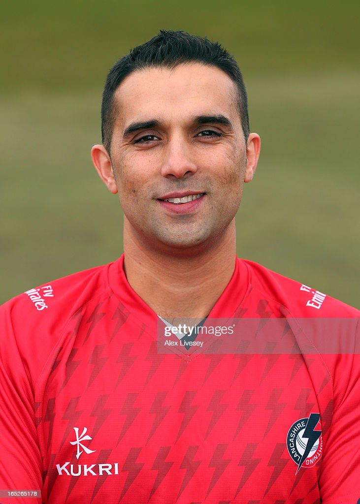 <a gi-track='captionPersonalityLinkClicked' href=/galleries/search?phrase=Kabir+Ali&family=editorial&specificpeople=214725 ng-click='$event.stopPropagation()'>Kabir Ali</a> of Lancashire CCC wears the T20 kit during a pre-season photocall at Old Trafford on April 2, 2013 in Manchester, England.