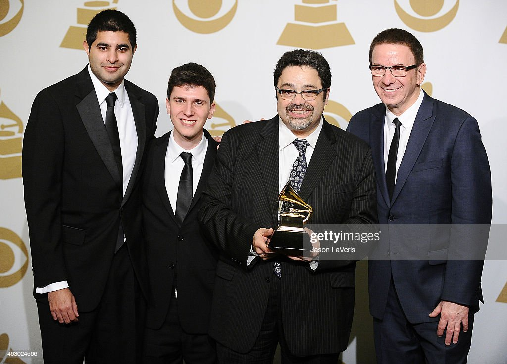 The Afro Latin Jazz Orchestra and recording artist <a gi-track='captionPersonalityLinkClicked' href=/galleries/search?phrase=Arturo+O%27Farrill&family=editorial&specificpeople=6649010 ng-click='$event.stopPropagation()'>Arturo O'Farrill</a> (CR), winners of Best Latin Jazz Album for 'The Offense Of The Drum,' pose in the press room at the 57th GRAMMY Awards at Staples Center on February 8, 2015 in Los Angeles, California.