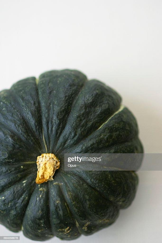 A Kabocha Pumpkin on a White Background