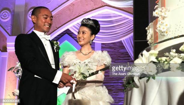 Kabuki actor Ebizo Ichikawa and former TV anchor Mao Kobayashi during their wedding on July 29 2010 in Tokyo Japan