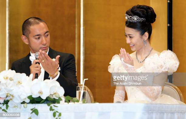 Kabuki actor Ebizo Ichikawa and former TV anchor Mao Kobayashi show their wedding bands at the press conference after their wedding on July 29 2010...