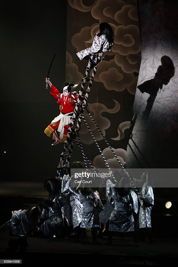 Kabuki actor Shido Nakamura (in red) performs in a final dress rehearsal for the kabuki theatre show 'Hanakurabe Senbonzakura' on April 28, 2016 in Tokyo, Japan. The latest digital technology kabuki theatre piece 'Hanakurabe Senbonzakura' is part of the Niconico Chokaigi festival in Tokyo. The festival was organized by video website Niconico, combining Kabuki, a traditional Japanese theater art and cutting edge animation technology, co-starring kabuki superstar <a gi-track='captionPersonalityLinkClicked' href=/galleries/search?phrase=Shidou+Nakamura&family=editorial&specificpeople=772833 ng-click='$event.stopPropagation()'>Shidou Nakamura</a> and the popular virtual idol Hatsune Miku.