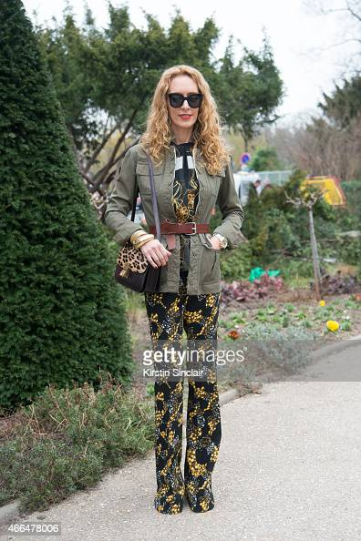 Kabuki art director Elina Halimi wears Giambattista Valli blouse and trousers Celine bag and Celine sunglasses on day 7 of Paris Collections Women on...