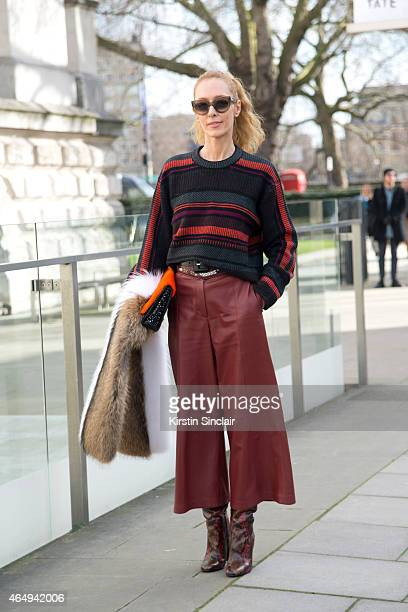 Kabuki Art Director Elina Halimi wears Proenza Schouler trousers bag and sweater Barbara Bui shoes and Celine sunglasses on February 24 2015 in...