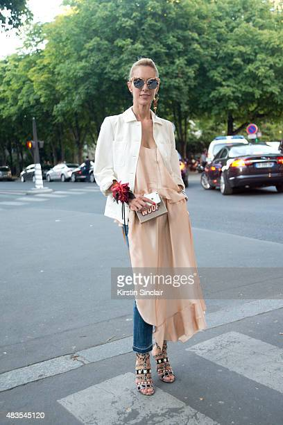 Kabuki boutique owner Elina Halimi wears a Stella McCartney dress and jacket with Alaïa shoes Gentle Monster sunglasses and a Louis Vuitton earring...