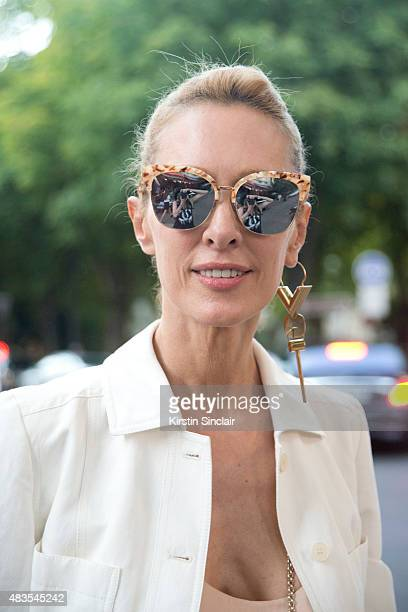 Kabuki boutique owner Elina Halimi wears a Stella McCartney dress and jacket Gentle Monster sunglasses and a Louis Vuitton earring on day 2 of Paris...