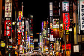 TOKYO, JAPAN - OCTOBER 15, 2017. Kabukicho pass illuminated at night in Shinjuku district, Tokyo. The area is a commercial an entertainment zone