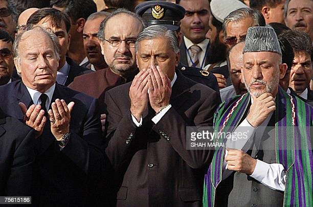 Afghan President Hamid Karzai Pakistani Prime Minister Shaukat Aziz and the Aga Khan join in the last prayer at the coffin of former King of...