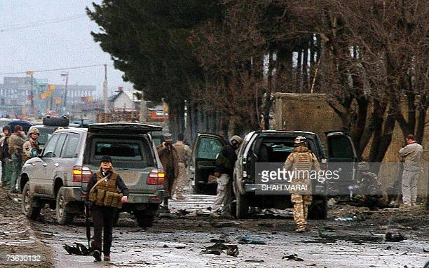 Investigators inspect the site of a suicide attack on a US Embassy convoy on the Jalalabad Road in Kabul 19 March 2007 A suicide attacker drove an...