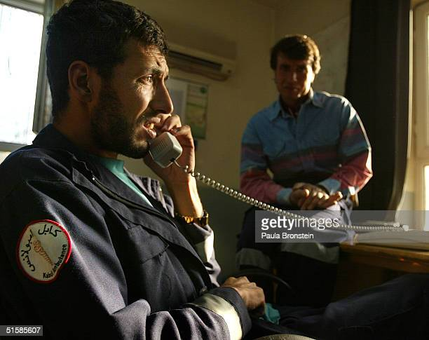 Kabul ambulance worker Yarmohammed takes a call on the emergency 112 line at the call center for kabul Ambulance October 27 2004 in Kabul Afghanistan...
