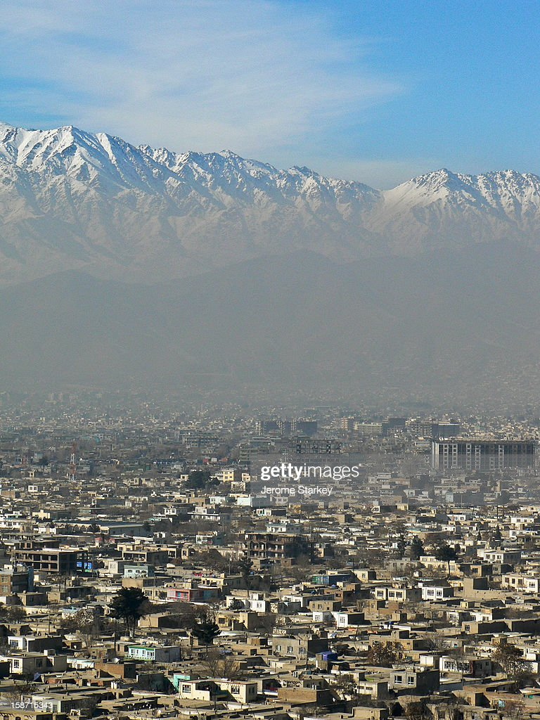 CONTENT] Kabul as seen from Swimming Pool Hill, in Wazir Akbar Khan, the diplomatic quarter. Smog from the city's stoves, generators and cars obscures the snow-capped Hindu Kush mountains which surround the ancient Silk Road city.
