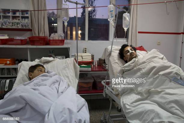 Kabul on February 28 2016 In the emergency room a boy over at another patient getting treatment at the Emergency hospital in Kabul Every year the UN...