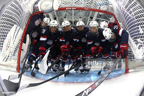 Kacey Bellamy Amanda Kessel Kelli Stack Megan Bozek Hilary Knight Michelle Picard and Kendall Coyne of the United States huddle around the net before...