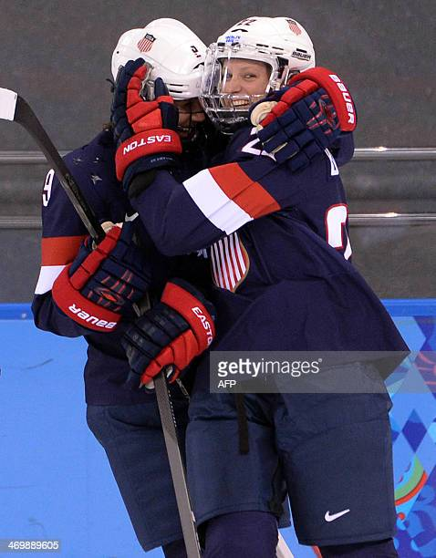 US Kacey Bellamy celebrates a goal with her team mate Megan Bozek during the Women's Ice Hockey Playoffs Semifinals match USA vs Sweden at the Shayba...