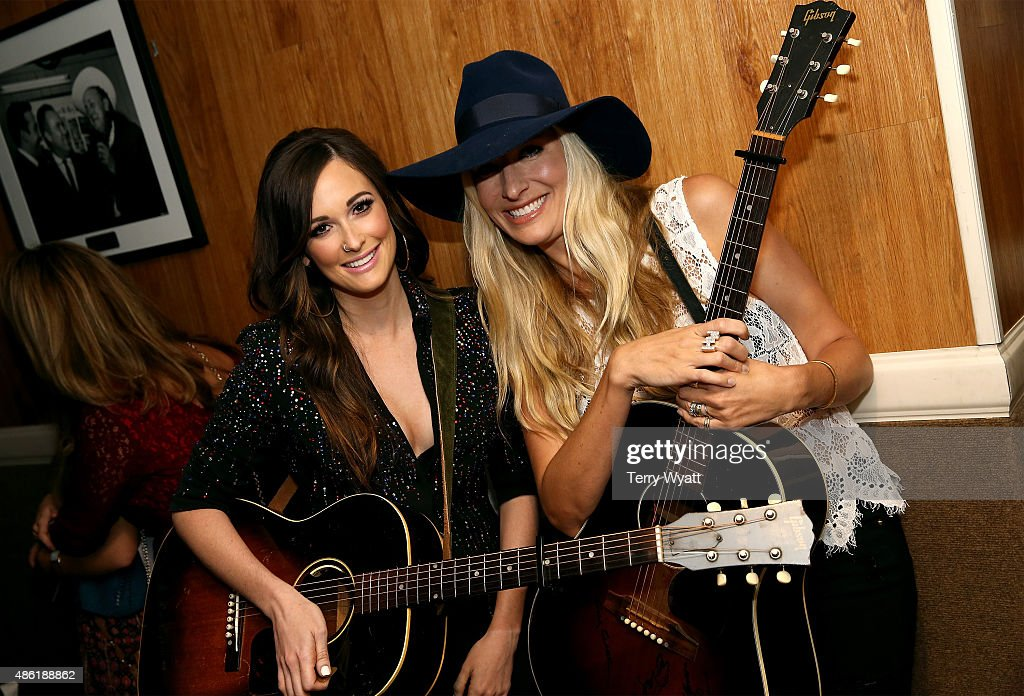 Kacey Musgraves and Holly Williams pose backstage during the 9th Annual ACM Honors at the Ryman Auditorium on September 1 2015 in Nashville Tennessee