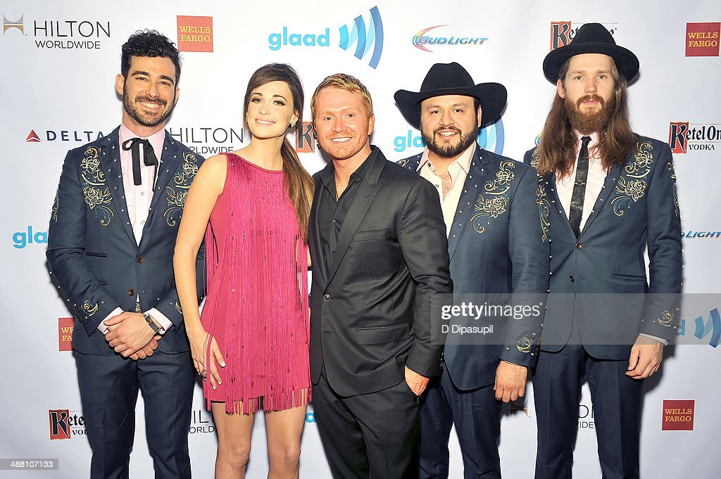 <a gi-track='captionPersonalityLinkClicked' href=/galleries/search?phrase=Kacey+Musgraves&family=editorial&specificpeople=4103138 ng-click='$event.stopPropagation()'>Kacey Musgraves</a> (C) and <a gi-track='captionPersonalityLinkClicked' href=/galleries/search?phrase=Shane+McAnally&family=editorial&specificpeople=9655977 ng-click='$event.stopPropagation()'>Shane McAnally</a> attend the 25th Annual GLAAD Media Awards on May 3, 2014 in New York City.