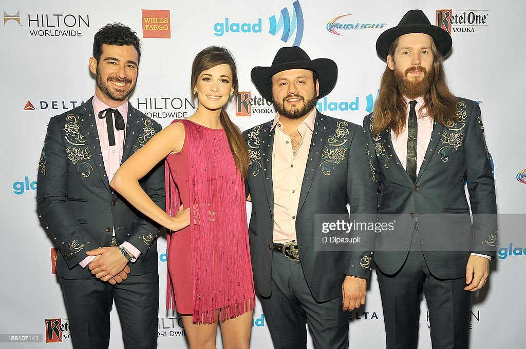 <a gi-track='captionPersonalityLinkClicked' href=/galleries/search?phrase=Kacey+Musgraves&family=editorial&specificpeople=4103138 ng-click='$event.stopPropagation()'>Kacey Musgraves</a> (C) attends the 25th Annual GLAAD Media Awards on May 3, 2014 in New York City.