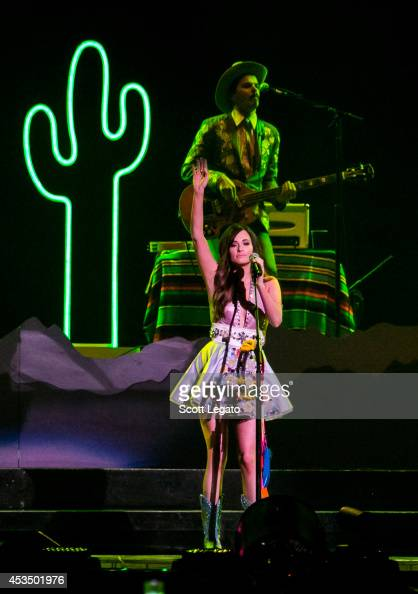 Kacey Musgraves performs onstage before Katy Perry during 'The Prismatic World Tour' at The Palace of Auburn Hills on August 11 2014 in Auburn Hills...