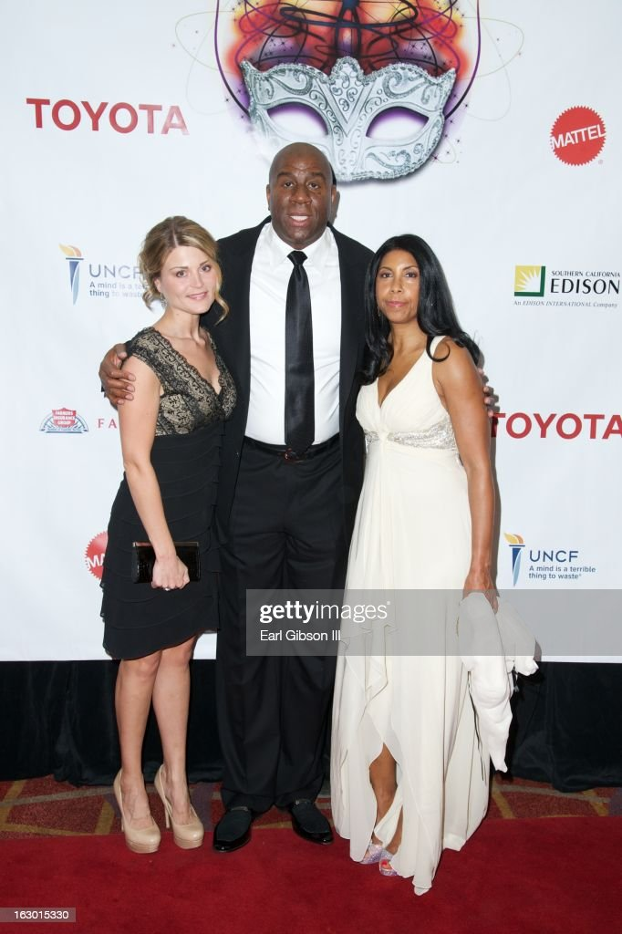 Kacey Taylor, Earvin 'Magic' Johnson and <a gi-track='captionPersonalityLinkClicked' href=/galleries/search?phrase=Cookie+Johnson&family=editorial&specificpeople=846852 ng-click='$event.stopPropagation()'>Cookie Johnson</a> pose for a photo on the red carpet at the UNCF Mayor's Masked Ball Hosted By Mayor Antonio Villaraigosa at Hilton Universal City on March 2, 2013 in Universal City, California.
