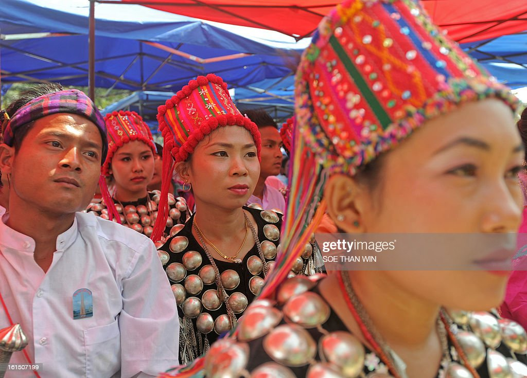 Kachin ethnic people attend a ceremony of the National League for Democracy (NLD) marking Myanmar's 66th Union Day anniversary in Yangon on February 12, 2013. Aung San Suu Kyi's National League for Democracy (NLD) said on February 11 it would hold its first ever national congress on March 8-10, reflecting the dramatic political changes sweeping Myanmar. AFP PHOTO/ Soe Than WIN