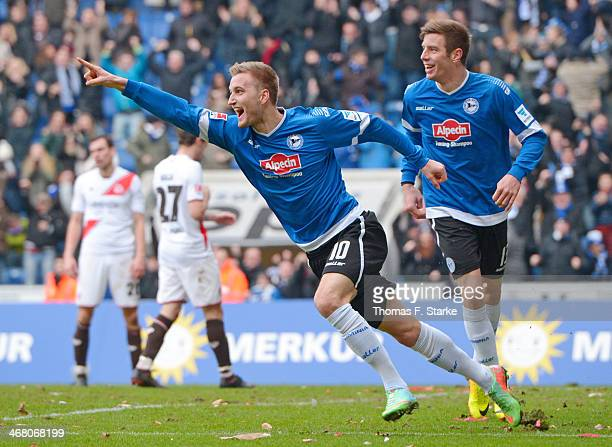 Kacper Przybylko and Johannes Rahn of Bielefeld celebrate their teams second goal during the Second Bundesliga match between Arminia Bielefeld and FC...