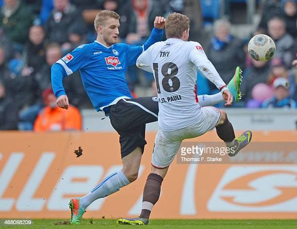 Kacper Przybylko of Bielefeld and Lennart Thy of St Pauli fight for the ball during the Second Bundesliga match between Arminia Bielefeld and FC St...