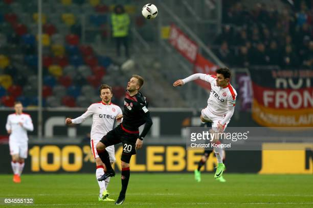 Kacper Przybylko of Kaiserslautern and Kaan Ayhan of Duesseldorf go up for a header during the Second Bundesliga match between Fortuna Duesseldorf...