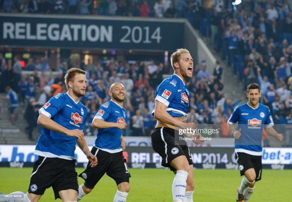 Kacper Przybylko, Philipp Riese, 19 and Stephan Salger of Bielefeld celebrate their teams first goal during the Second Bundesliga Playoff Second Leg match between Arminia Bielefeld and Darmstadt 98 at Schueco Arena on May 19, 2014 in Bielefeld, Germany.