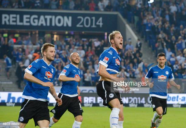 Kacper Przybylko Philipp Riese 19 and Stephan Salger of Bielefeld celebrate their teams first goal during the Second Bundesliga Playoff Second Leg...