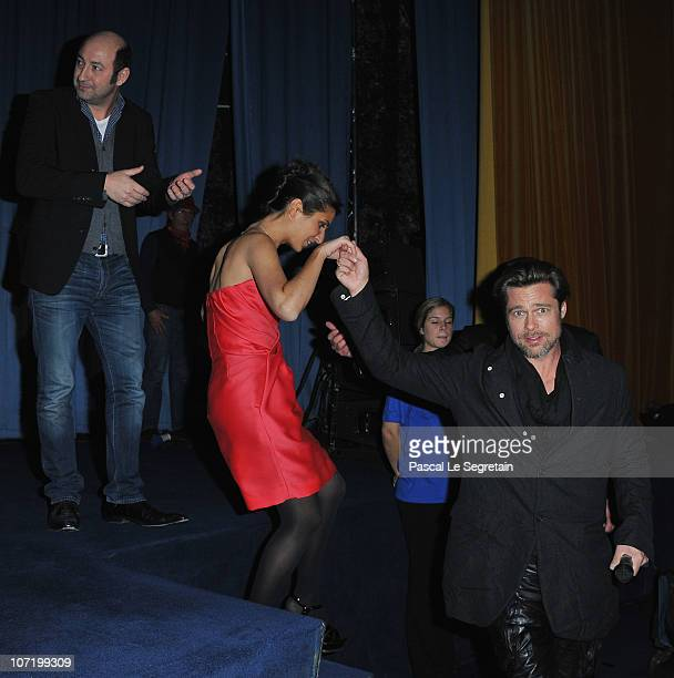 Kad Merad Geraldine Nakache and Brad Pitt attend the 'Megamind' Paris premiere on November 29 2010 in Paris France