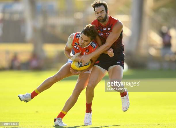 Kade Kolodjashnij of the Suns and Jordan Lewis of the Demons bump each other during the round ten AFL match between the Melbourne Demons and the Gold...