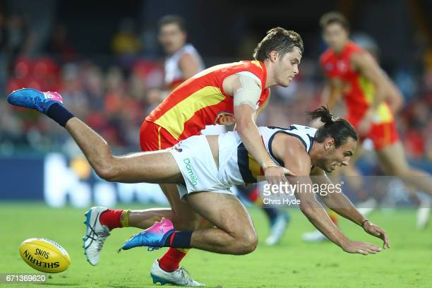 Kade Kolodjashnij of the Suns and Troy Menzel of the Crows compete for the ball during the round five AFL match between the Gold Coast Suns and the...