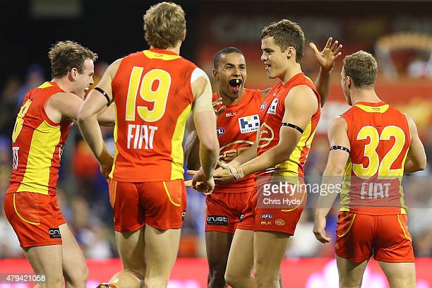 Kade Kolodjashnij of the Suns celebrates a goal during the round 14 AFL match between the Gold Coast Suns and the North Melbourne Kangaroos at...