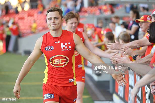 Kade Kolodjashnij of the Suns celebrates winning the round 18 AFL match between the Gold Coast Suns and the Fremantle Dockers at Metricon Stadium on...
