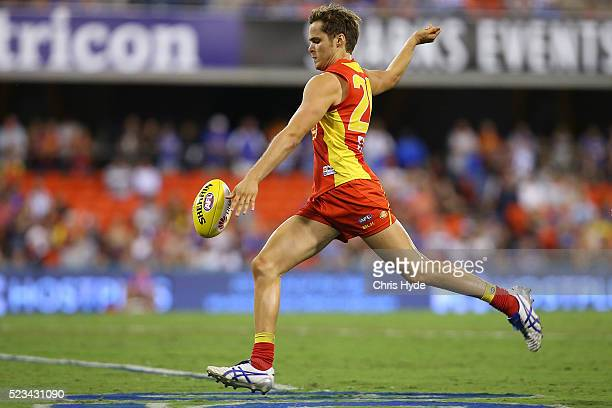 Kade Kolodjashnij of the Suns kicks during the round five AFL match between the Gold Coast Suns and the North Melbourne Kangaroos at Metricon Stadium...