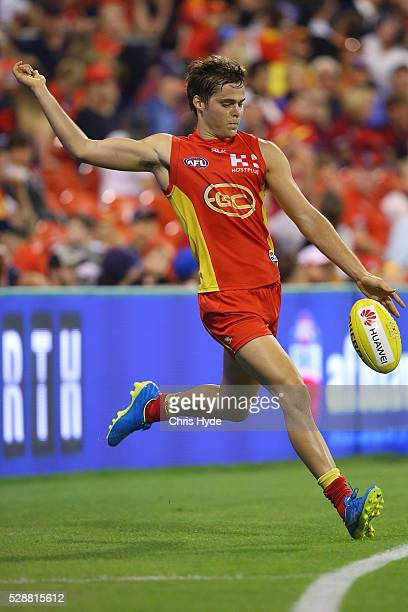 Kade Kolodjashnij of the Suns kicks during the round seven AFL match between the Gold Coast Suns and the Melbourne Demons at Metricon Stadium on May...