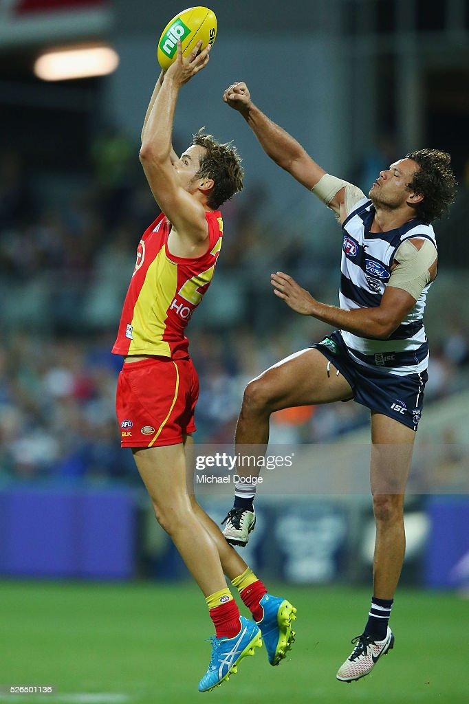 Kade Kolodjashnij of the Suns marks the ball against Steven Motlop of the Cats during the round six AFL match between the Geelong Cats and the Gold Coast Suns at Simonds Stadium on April 30, 2016 in Geelong, Australia.