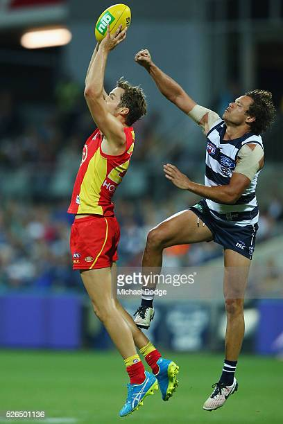 Kade Kolodjashnij of the Suns marks the ball against Steven Motlop of the Cats during the round six AFL match between the Geelong Cats and the Gold...