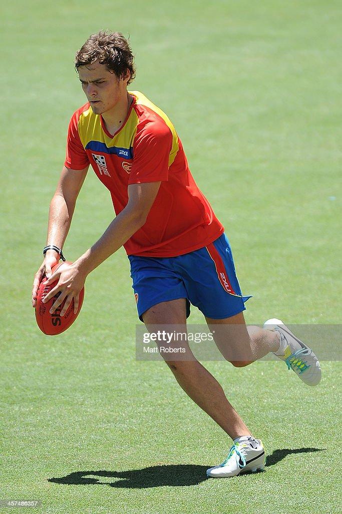 Kade Kolodjashnij runs with the ball during a Gold Coast Suns AFL pre-season training session at Metricon Stadium on December 18, 2013 on the Gold Coast, Australia.