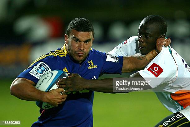 Kade Poki of the Highlanders is tackled during the round four Super Rugby match between the Highlanders and the Cheetahs at Rugby Park Stadium on...