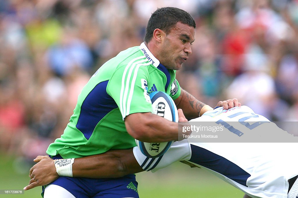 Kade Poki of the Highlanders is tackled during the Super Rugby trial match between the Highlanders and the Blues at the Queenstown Recreation Ground on February 15, 2013 in Queenstown, New Zealand.