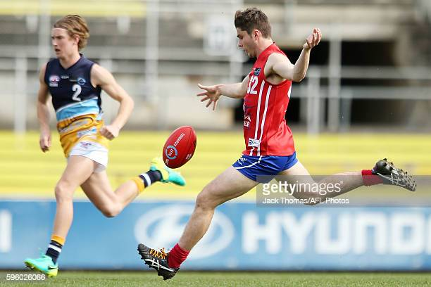 Kade Renooy of the Power kicks the ball during the round 18 TAC Cup match between Gippsland Power and Bendigo Pioneers at Ikon Park on August 27 2016...