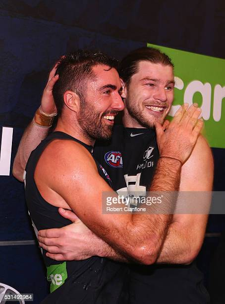 Kade Simpson and Bryce Gibbs of the Blues celebrate after the Blues defeated Port Adelaide during the round eight AFL match between the Carlton Blues...