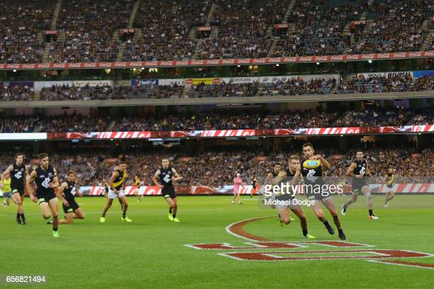 Kade Simpson kicks the ball during the round one AFL match between the Carlton Blues and the Richmond Tigers at Melbourne Cricket Ground on March 23...