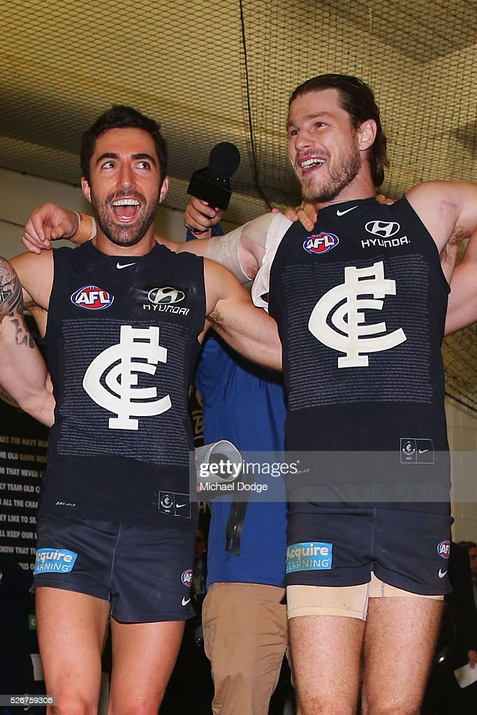 Kade Simpson of the Blues (L) and Bryce Gibbs sing the club song after winning during the round six AFL match between the Carlton Blues and the Essendon Bombers at Melbourne Cricket Ground on May 1, 2016 in Melbourne, Australia.