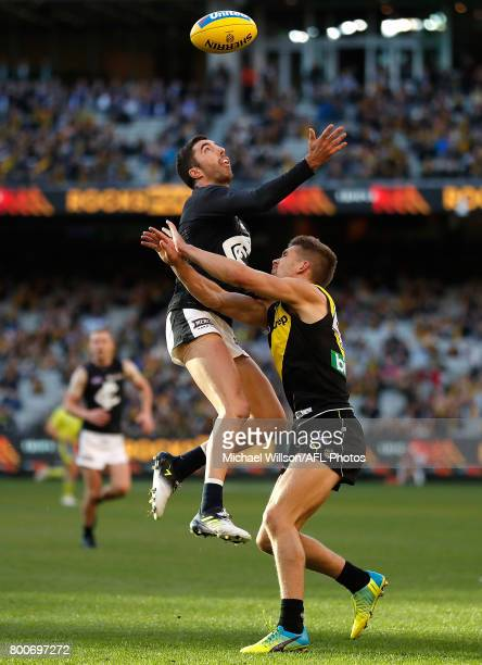 Kade Simpson of the Blues and Dan Butler of the Tigers compete for the ball during the 2017 AFL round 14 match between the Richmond Tigers and the...